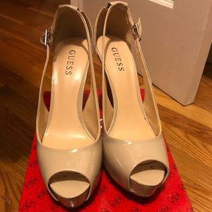Patent leather peep toe pumps